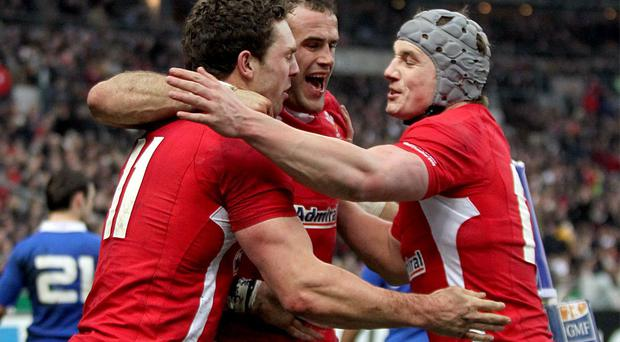 George North celebrates scoring a try with Jamie Roberts and Jonathan Davies