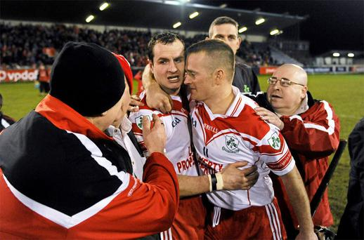 Liam Watson, Loughgiel Shamrocks, is congratulted by team-mates and supporters after the game