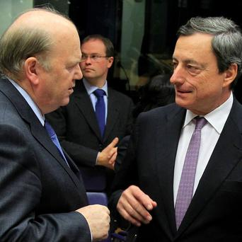 Michael Noonan with Mario Draghi at a eurozone finance ministers' meeting in 2012