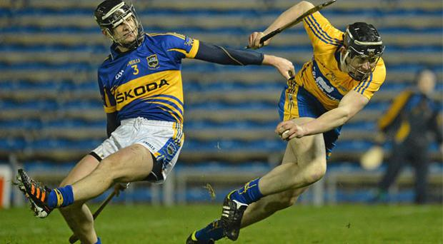 Clare's Alan O'Neill gets away from Paul Curran during the Waterford Crystal Cup final at Semple Stadium