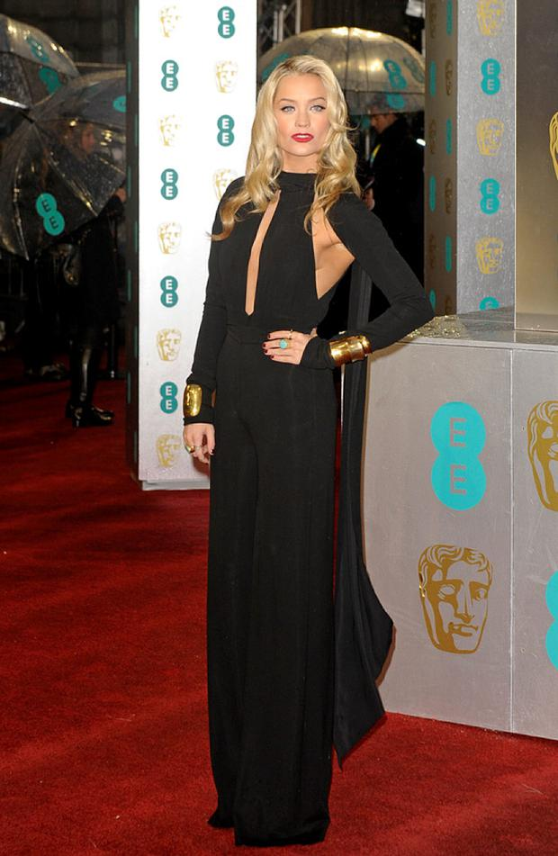 Laura Whitmore walks the red carpet at the BAFTAs last night