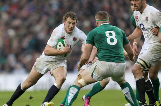 England's Billy Twelvetrees runs at Jamie Heaslip during the RBS 6 Nations match at the Aviva Stadium