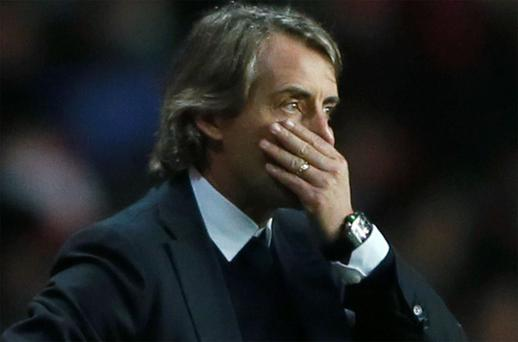 Manchester City manager Roberto Mancini reacts during their Premier League match against Southampton at St Mary's Stadium