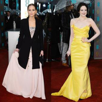 Jennifer Lawrence covers up while Andrea Riseborough braves the cold at the 2013 Bafta Awards.