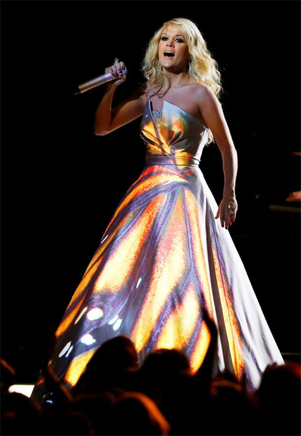 Carrie Underwood in the 'lightshow' dress designed by Don O'Neill (inset) at the Grammy Awards