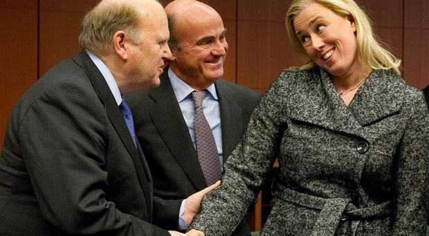 At the Eurogroup meeting in Brussels were, from left, Finance Minister Michael Noonan, Spanish Economy Minister Luis de Guindos, and Finnish Finance Minister Jutta Urpilainen