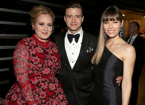 Justin Timberlake and wife Jessica Biel pose with Adele