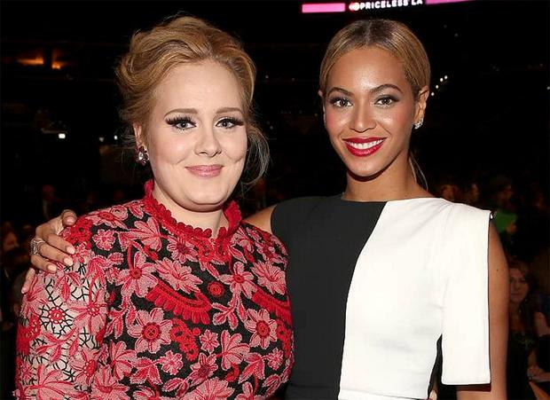 Adele with Beyonce at the Grammys.
