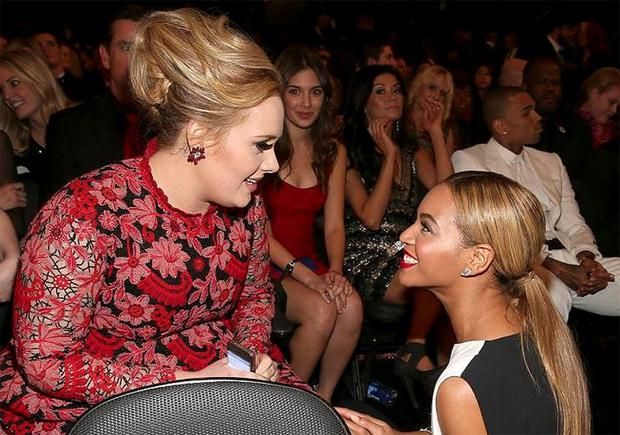 Beyonce was thrilled to talk to Adele as others looked on