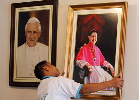 A portrait of Cardinal Luis Antonio Tagle of the Philippines is hung next to one of Pope Benedict XVI inside the Archbishop's headquarters in Manila