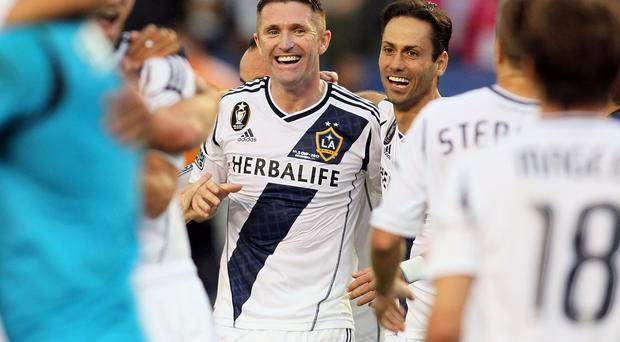 Robbie Keane of Los Angeles Galaxy celebrates after the Galaxy defeat the Houston Dynamo 3-1 to win the 2012 MLS Cup at The Home Depot Center in December