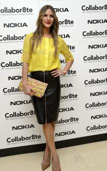 Amanda Byram wore an on-trend leather pencil skirt teamed with a bright yellow top