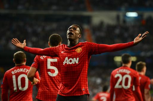 MADRID, SPAIN - FEBRUARY 13: Danny Welbeck of Manchester United celebrates scoring the opening goal during the UEFA Champions League Round of 16 first leg match between Real Madrid and Manchester United at Estadio Santiago Bernabeu on February 13, 2013 in Madrid, Spain. (Photo by Mike Hewitt/Getty Images)