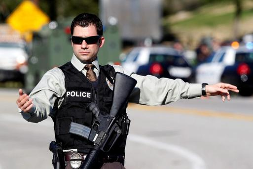 An armed police officer in Yucaipa during the manhunt