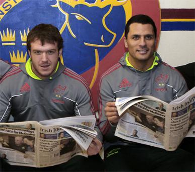 Among the 521,000 readers of the 'Irish Independent' are Munster's Mick Sherry (left) and Doug Howlett
