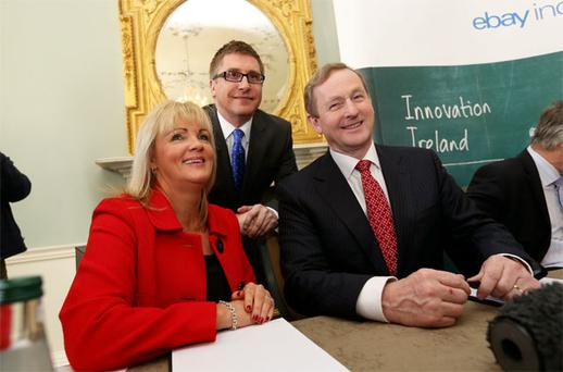 Taoiseach Enda Kenny at the announcement today with Ebay's Louise Phelan and Gary Hagel