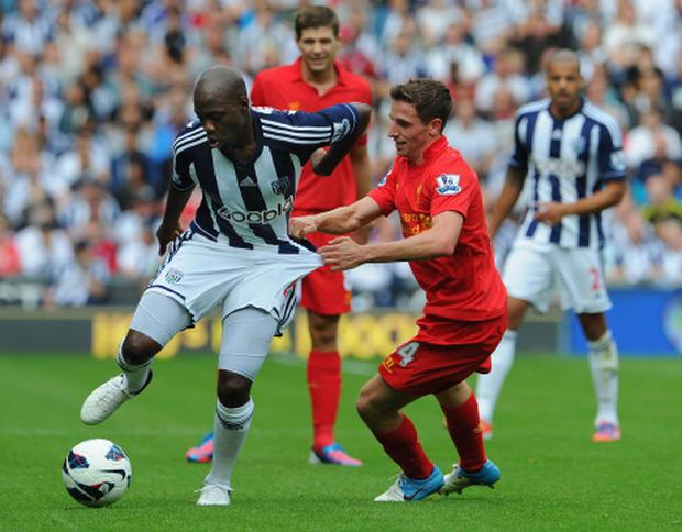 West Bromwich Albion v Liverpool - Premier League...WEST BROMWICH, ENGLAND - AUGUST 18: Joe Allen of Liverpool battles Youssouf Mulumbu of West Brom during the Barclays Premier League match between West Bromwich Albion and Liverpool at The Hawthorns on August 18, 2012 in West Bromwich, England. (Photo by Michael Regan/Getty Images)...S