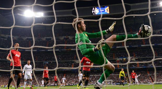 Manchester United keeper David De Gea makes a save with his foot during the second half of Wednesday's Champions League tie at the Bernabeu