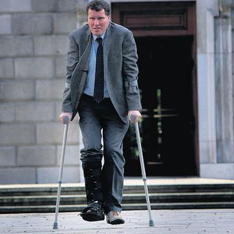 Anthony Lawlor was back to work at Leinster House after breaking his leg.
