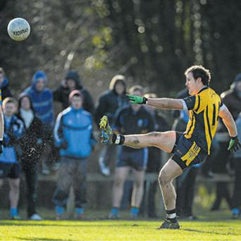 Michael Murphy scores a point from a free for DCU at St Clare's in Ballymun