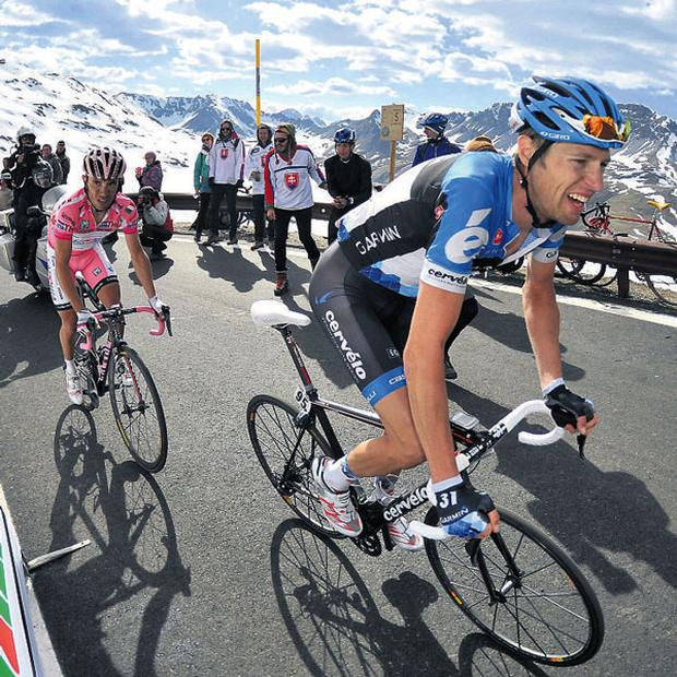 Canadian cyclist Ryder Hesjedal (R) climbs his way towards the leader's pink jersey ahead of Spanish cyclist Joaquim Rodriguez over the Passo dello Stelvio during last year's Giro d'Italia, which is to start in Ireland next year