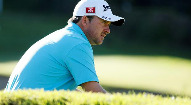Graeme McDowell waits his turn to putt on the 16th green at the Northern Trust Open