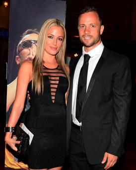 Oscar Pistorius and Reeva Steenkamp pose earlier this month.