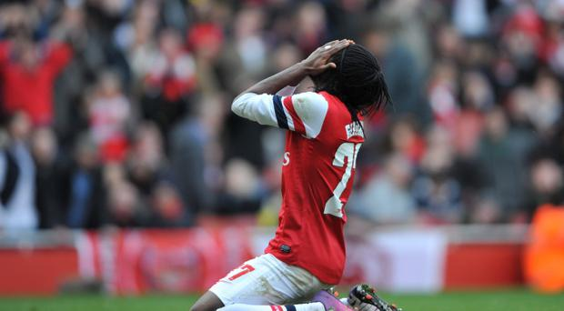 Arsenal's Gervinho reacts after missing a chance today