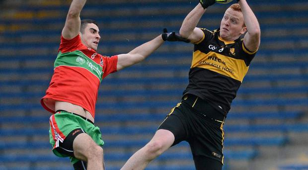Johnny Buckley, Dr. Crokes, in action against James McCarthy, Ballymun Kickhams.