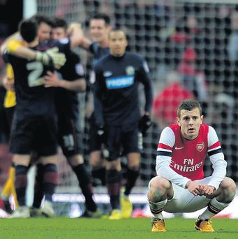 A dejected Jack Wilshere of Arsenal following his team's 1-0 defeat to Blackburn Rovers in the FA Cup fifth round at the Emirates Stadium