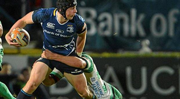 Leinster's Noel Reid is tackled by Dean Budd of Benetton Treviso