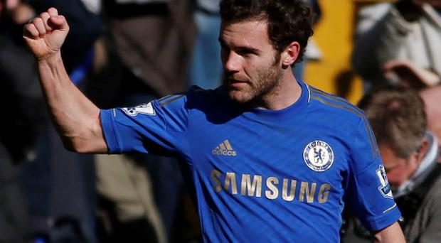 Chelsea's Juan Mata celebrates his goal against Brentford during their FA Cup fourth round replay soccer match at Stamford Bridge in London February 17, 2013. REUTERS/Eddie Keogh (BRITAIN - Tags: SPORT SOCCER)
