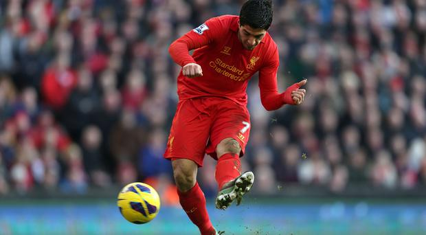 Liverpool's Luis Suarez scores his side's fourth goal today