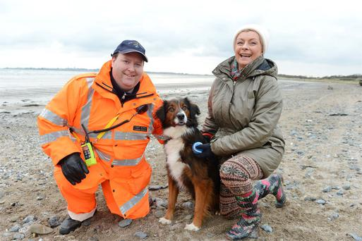 A grateful Colette Connolly with her dog Hector and his new best friend, Gary Creighton