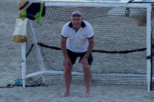 Anthony Lyons playing football on the beach in Dubai