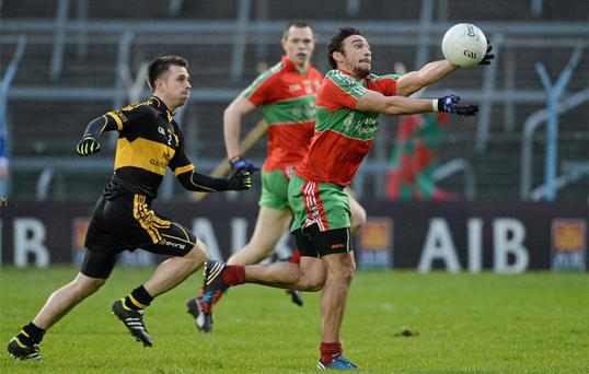 Ballymun goalscorer Ted Furman breaks away from Dr Crokes' John Payne at Semple Stadium