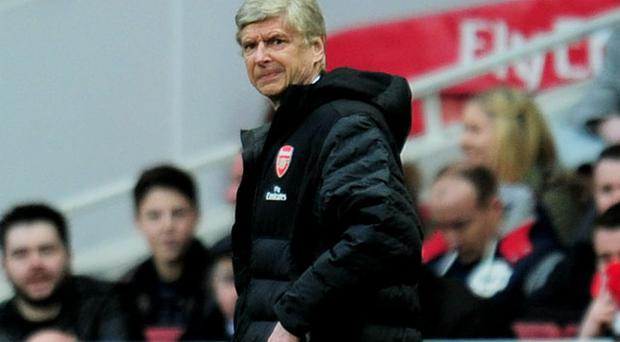 A dejected Arsene Wenger the Arsenal manager looks on during the FA Cup with Budweiser fifth round match between Arsenal and Blackburn Rovers