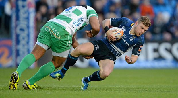 Ian Madigan is tackled by Manoa Vosawai of Benetton Treviso
