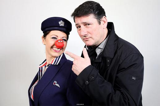 Tony Hadley getting ready for his gig in the sky with a member of British Airways cabin crew