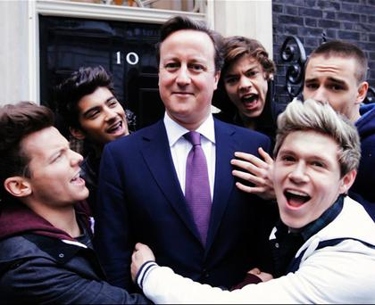 David Cameron makes a cameo with One Direction in a scene from their new video, photo released Monday 18 February.