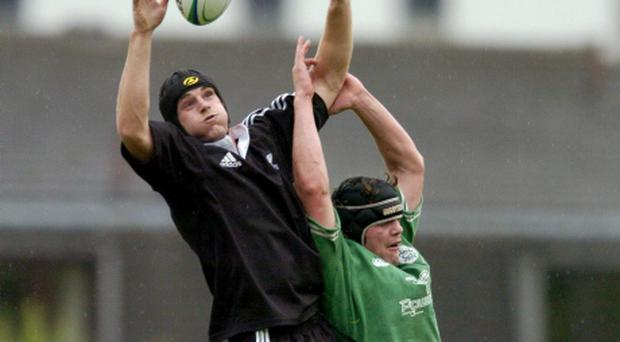 Craig Clarke, New Zealand, wins the lineout from David Gannon in this photo dated from 2004