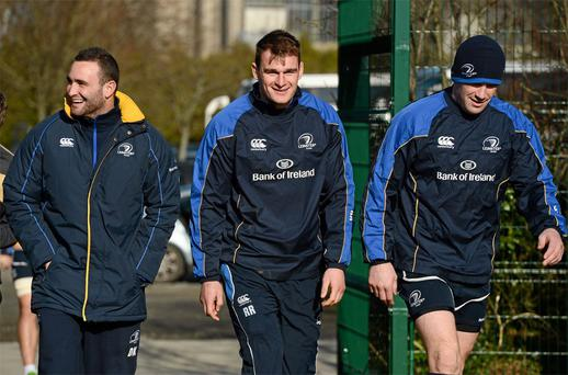 Leinster players David Kearney, left, Rhys Ruddock, and Shane Jennings, right, arrive for squad training ahead of their side's Celtic League match against Scarlets on Saturday