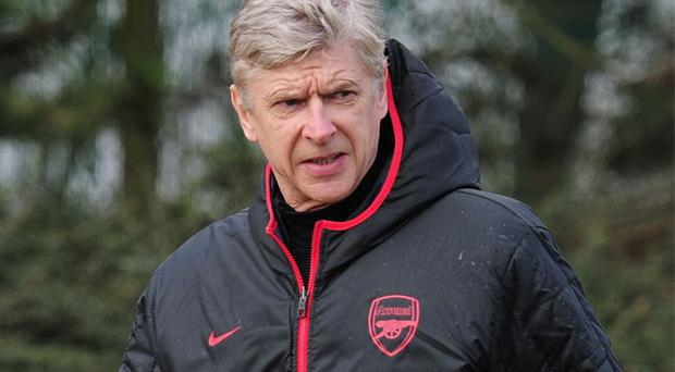 Arsenal manager Arsene Wenger oversees a training session ahead of their UEFA Champions League round of 16 first leg match against Bayern Munich