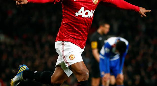 Manchester United's Nani celebrates after scoring his side's first goal against Reading
