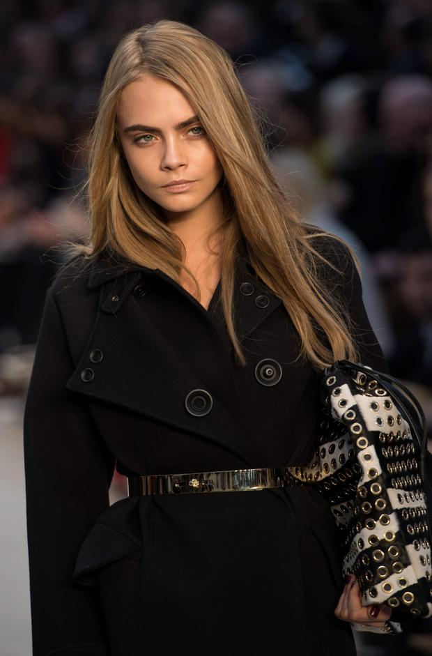 Cara Delevingne walks the runway during the Burberry Prorsum show