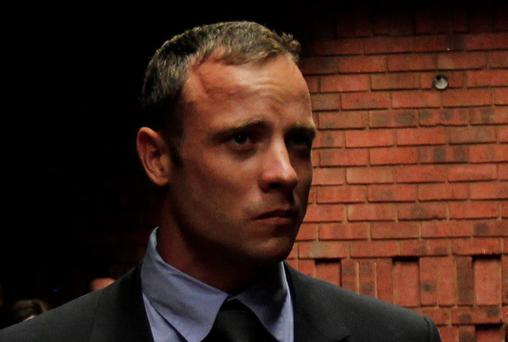 Oscar Pistorius awaits the start of court proceedings today