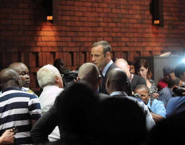 South African 'Blade Runner' Oscar Pistorius leaves court after appearing in Pretoria February 15, 2013. REUTERS/Antonie de Ras