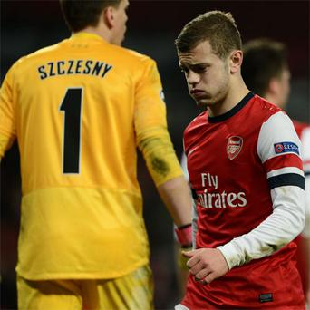 Jack Wilshere reacts after the defeat