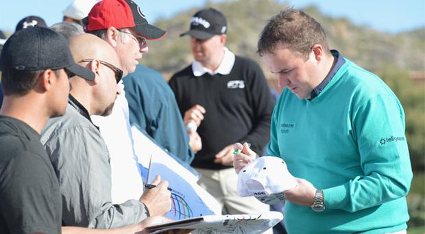 Shane Lowry signs an autograph during practice prior to the start of the World Golf Championships-Accenture Match Play Championship