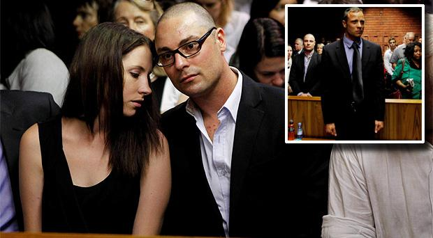 Oscar Pistorius' sister Aimee and brother Carl await the start of court proceedings in the Pretoria Magistrates court today